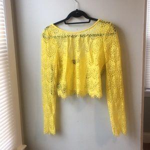 Yellow Bebe sheet lace crop top size large